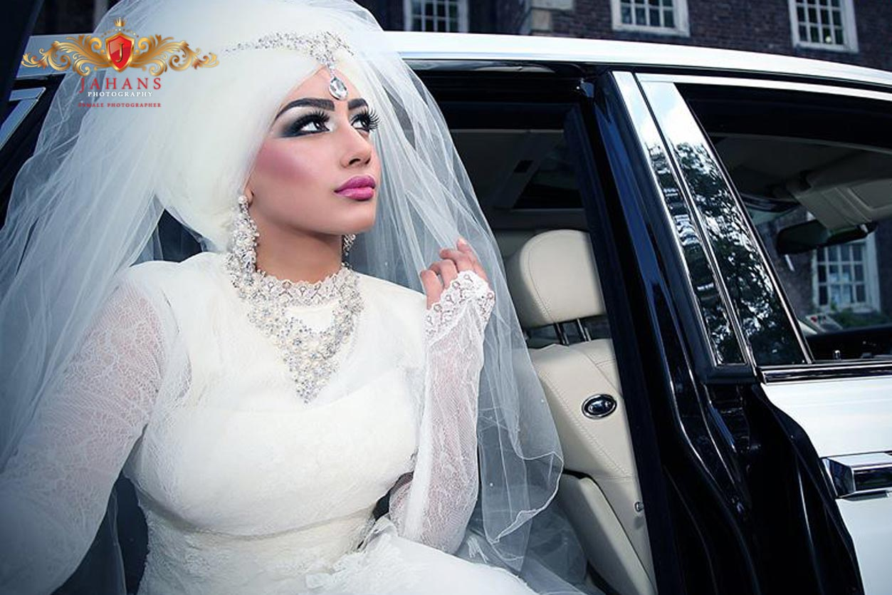 photograph of pakistani asian bride in white dress